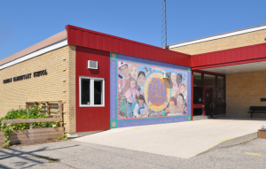 Photo of the mural on the front of the school at Carman Elementary
