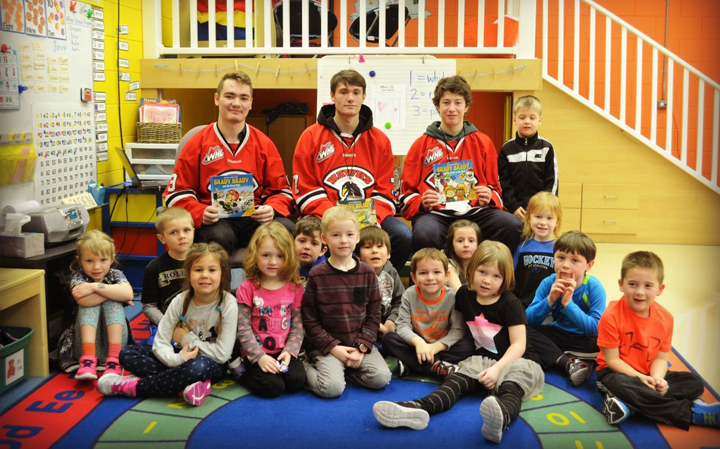 Pembina Valley Midget Hawks read to KG Kindergarten students